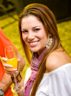 A young woman with a mimosa cocktail.